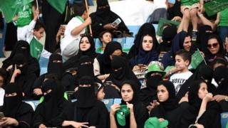 Saudi women sit in a stadium to attend an event in the capital Riyadh on 23 September
